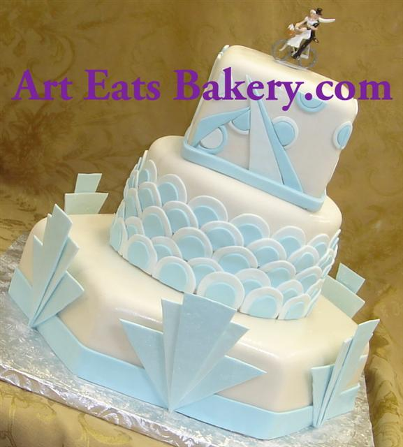 White three tier hexagon and round art deco style fondant wedding cake