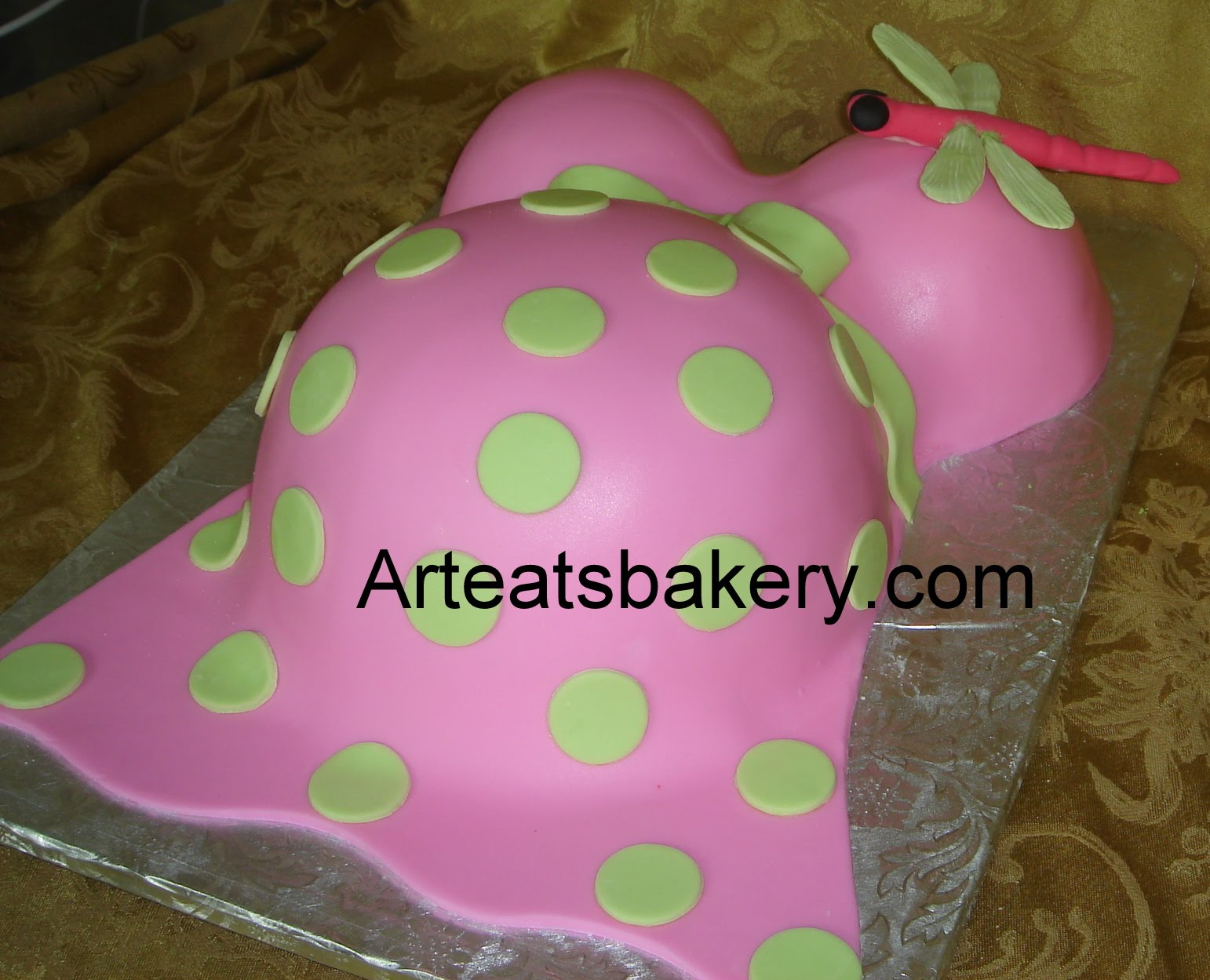 Pink and green fondant baby bump shower cake with ...