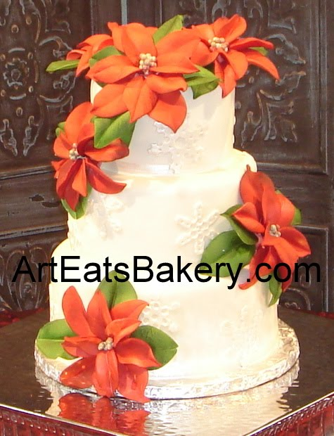 Three tier white fondant wedding cake with pearl snowflakes and red sugar